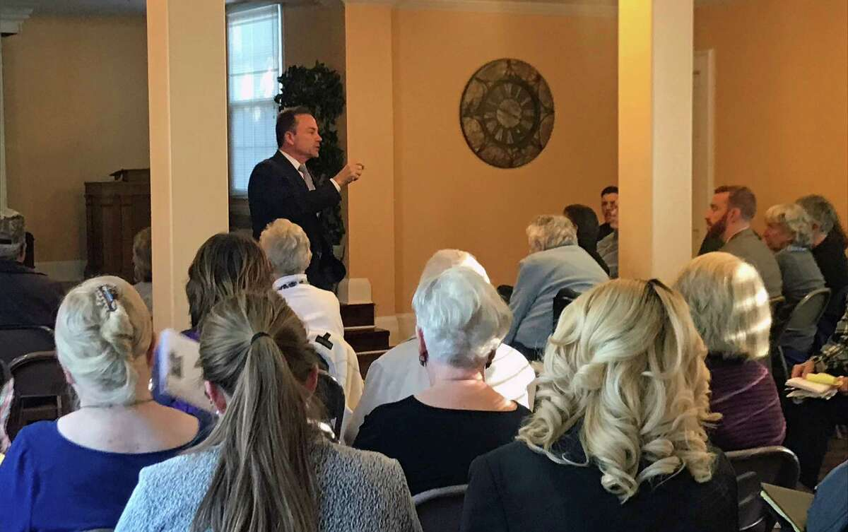 Bridgeport, Conn., Mayor Joe Ganim addresses the crowd of more than 50 people who attended a forum about flooding on Oct. 18, 2018.