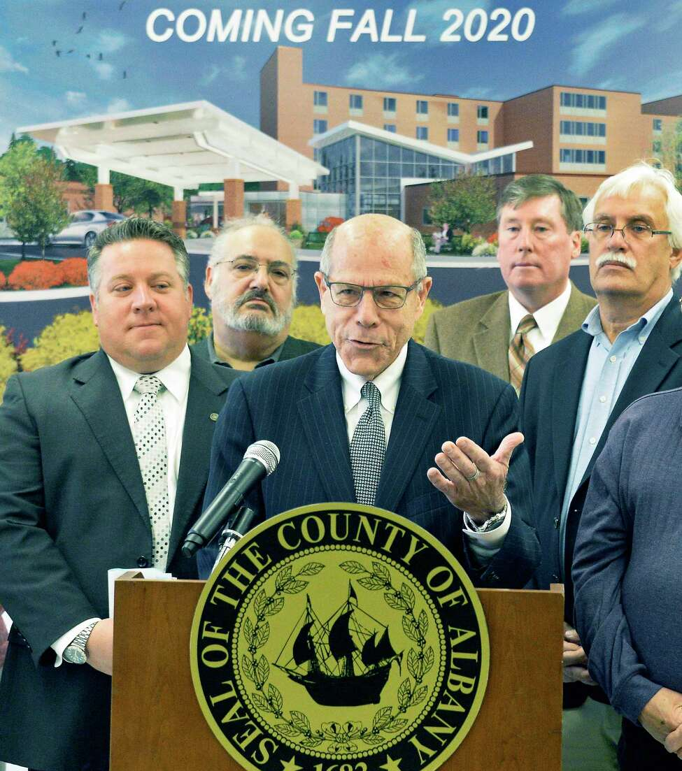 Executive director Larry Slatky, center, speaks during a news conference on the renovations of the Albany County Nursing Home Thursday Oct. 18, 2018 in Colonie, NY. At left is Albany County Executive Dan McCoy. (John Carl D'Annibale/Times Union)
