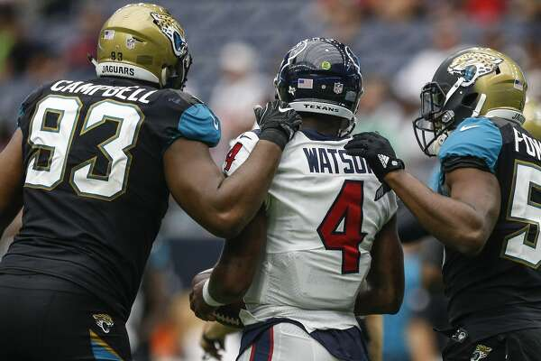 Jacksonville Jaguars defensive tackle Calais Campbell (93) and defensive end Dante Fowler (56) talk to Houston Texans quarterback Deshaun Watson (4) after the last Texans offensive possession of the game as the Houston Texans lose to the Jacksonville Jaguars 29-7 at NRG Stadium Sunday, Sept. 10, 2017 in Houston. ( Michael Ciaglo / Houston Chronicle)