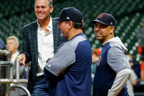 Former Astro Craig Biggio and Boston Red Sox manager Alex Cora talk before Game 5 of the American League Championship Series at Minute Maid Park on Thursday, Oct. 18, 2018, in Houston.