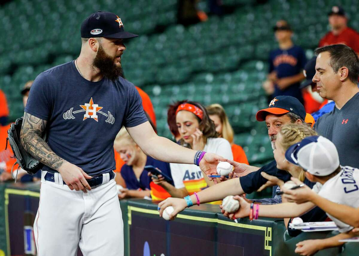Houston Astros pitcher Dallas Keuchel (60) signs autographs before Game 5 of the American League Championship Series at Minute Maid Park on Thursday, Oct. 18, 2018, in Houston.