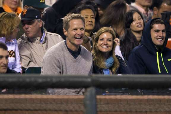 Head coach Steve Kerr of the Golden State Warriors sits in the stands with his wife Margot Kerr during the fifth inning between the San Francisco Giants and the New York Mets at AT&T Park on June 7, 2014 in San Francisco, California. The San Francisco Giants defeated the New York Mets 5-4.