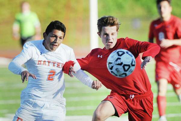 Danbury's Jorge Guerreo (#2), left, and Sasha Burnett of Greenwich vie for the ball during the boys high school soccer match between Greenwich High School and Danbury High School at Greenwich, Conn., Thursday, Oct. 18, 2018.