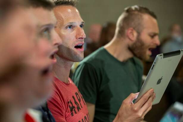Member of the San Francisco Gay Men's Chorus, Justin Donahue, sings during a rehearsal held on Monday, October 15, 2018 in San Francisco, Calif.