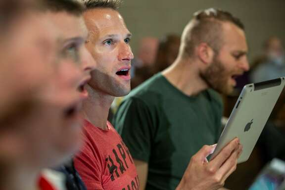 Member of the San Francisco Gay Men's Chorus, Justin Donahue, sings during a rehearsal held on Monday, October 15, 2018 in San Francisco, Calif.