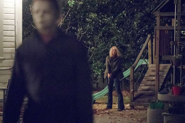 Michael Myers (James Jude Courtney) and Laurie Strode (Jamie Lee Curtis) return in ?Halloween.? MUST CREDIT: Ryan Green, Universal Pictures