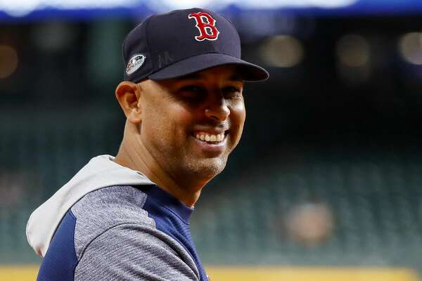 "Boston Red Sox manager Alex Cora laughs as people sing ""Happy Birthday"" to him before Game 5 of the American League Championship Series at Minute Maid Park on Thursday, Oct. 18, 2018, in Houston."