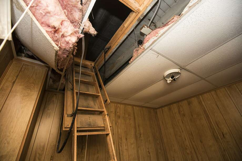 The badly decomposed bodies of 11 infants were found inside of the false ceiling on each side of the attic ladder at the former Cantrell Funeral Home on Mack Avenue in Detroit, Saturday, Oct. 13, 2018. (Junfu Han/Detroit Free Press/TNS) Photo: Junfu Han, TNS