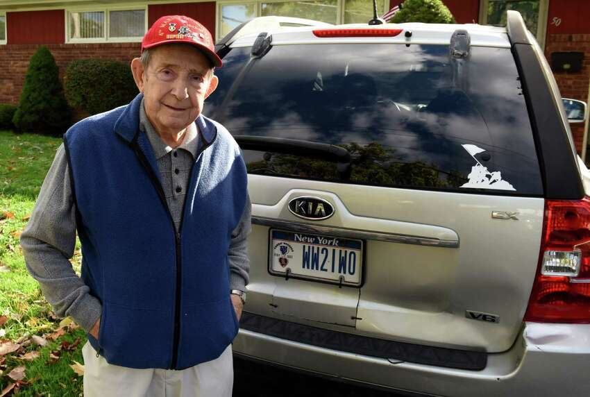 World War II Battle of Iwo Jima veteran Tom Lemme with his personalized license plate on Tuesday, Oct. 16, 2018, in Albany, N.Y. (Will Waldron/Times Union)