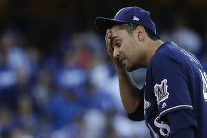 Milwaukee Brewers' Joakim Soria reacts after giving up a double to Los Angeles Dodgers' Cody Bellinger during the seventh inning of Game 5 of the National League Championship Series baseball game Wednesday, Oct. 17, 2018, in Los Angeles. (AP Photo/Matt Slocum)