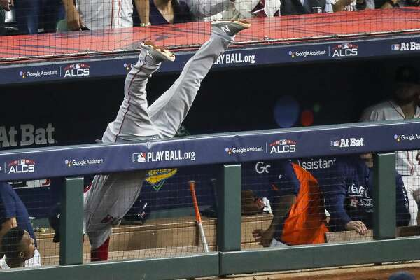 Boston Red Sox Steve Pearce (25) cannot reach a foul ball in the Astros dugout during the seventh inning of Game 4 of the American League Championship Series at Minute Maid Park on Wednesday, Oct. 17, 2018, in Houston.