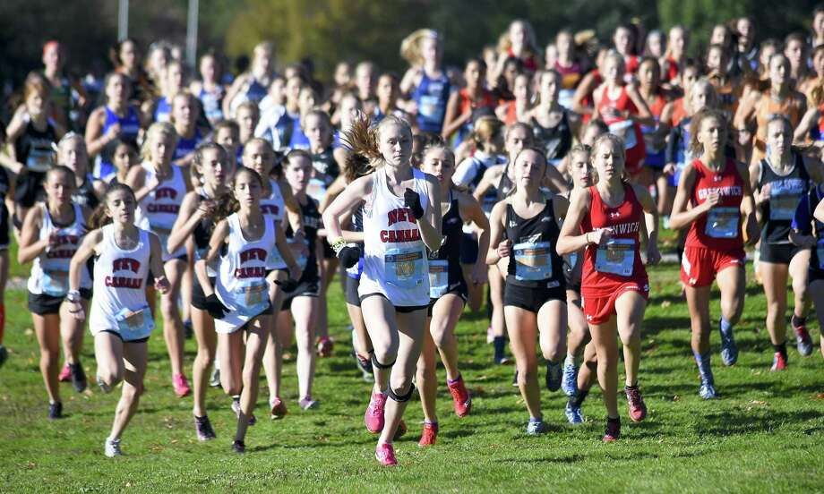Competitors take off at the start of the FCIAC Girls Cross Country Championships on Thursday at Waveny Park in New Canaan. Photo: Matthew Brown / Hearst Connecticut Media / Stamford Advocate