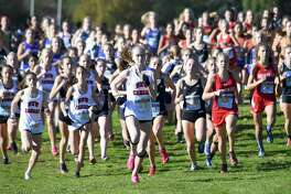 Competitors take off at the start of the FCIAC Girls Cross Country Championships on Thursday at Waveny Park in New Canaan.