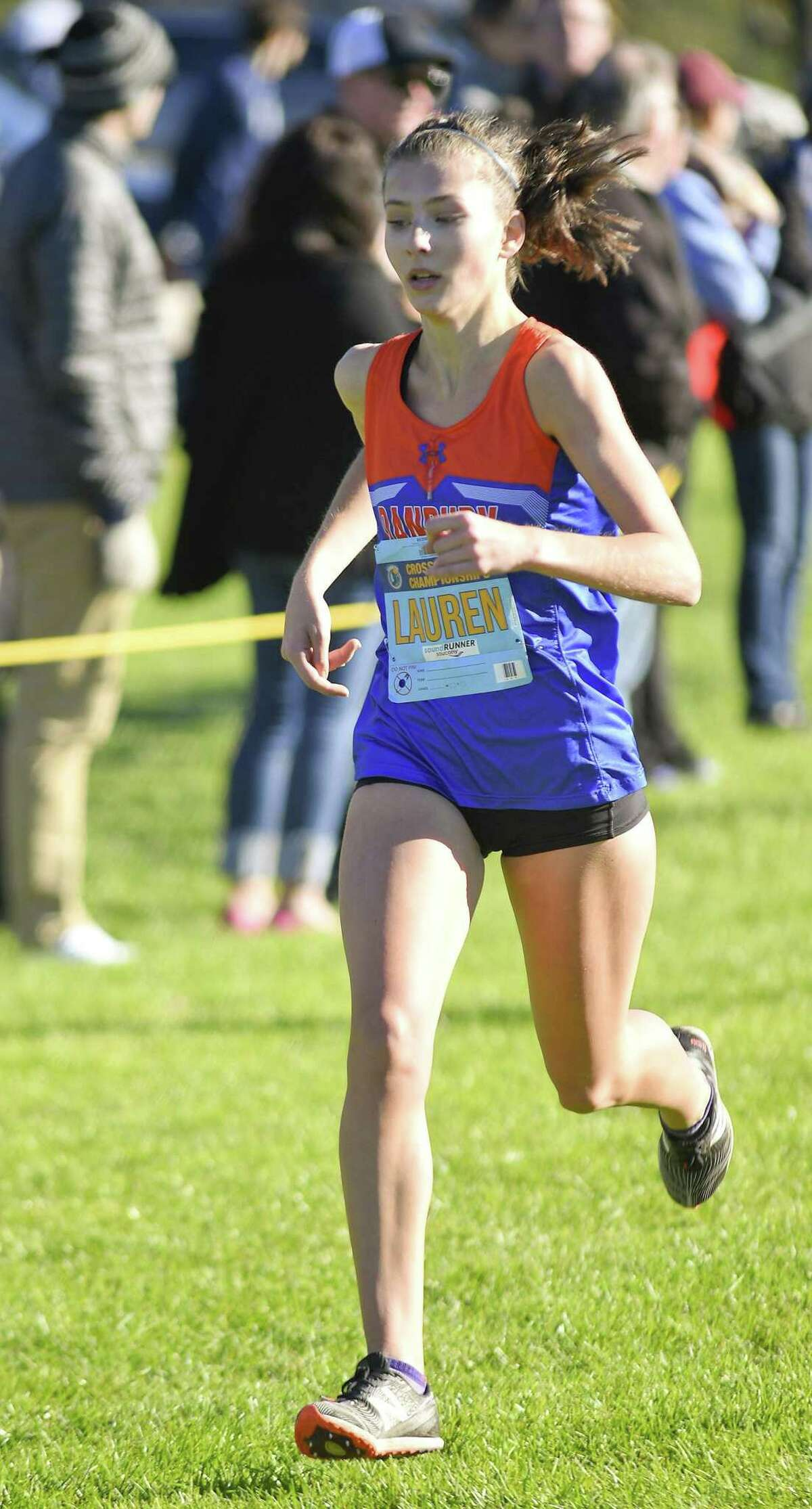 Danbury's Lauren Moore heads to the finish line during the 2018 Cross Country Championships at Waveny Park in New Canaan, Connecticut., Thursday, Oct. 18, 2018. Moore was edged out of first place, at the line by Ridgefield's Gabriella Viggiano, who finished with a time of 14:39.07 to Moore's 14:39.53.