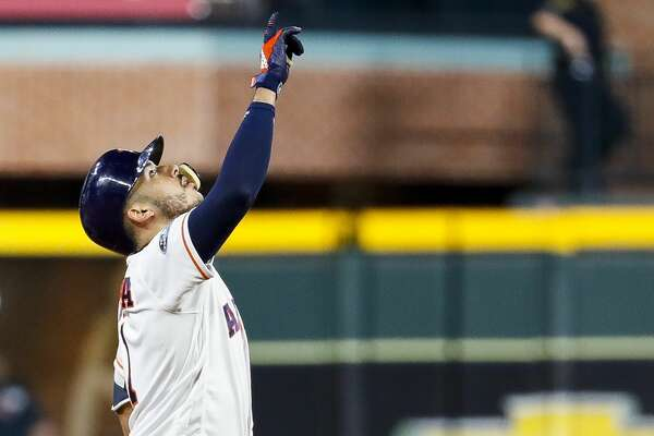 Houston Astros Carlos Correa (1) doubles on a line drive to right field during the seventh inning of Game 4 of the American League Championship Series at Minute Maid Park on Wednesday, Oct. 17, 2018, in Houston.