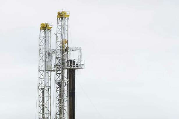 A drilling rig works Wednesday, Oct. 18, 2018 a few miles outside Kenedy in the heart of the Eagle Ford shale oil play.