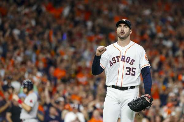 Houston Astros starting pitcher Justin Verlander (35) reacts after striking out Boston Red Sox Mookie Betts (50) with the bases loaded to end the top of the second inning of Game 5 of the American League Championship Series at Minute Maid Park on Thursday, Oct. 18, 2018, in Houston.