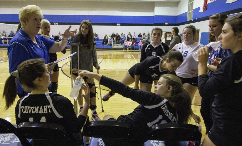Covenant Christian High School volleyball head coach Diane Severson speaks with the team in between the second and third sets of a TAPPS District 6-2A match Wednesday, Oct. 18, 2018 at Covenant High School in Conroe. Photo: Cody Bahn, Houston Chronicle / Staff Photographer / © 2018 Houston Chronicle