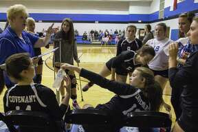 Covenant Christian High School volleyball head coach Diane Severson speaks with the team in between the second and third sets of a TAPPS District 6-2A match Wednesday, Oct. 18, 2018 at Covenant High School in Conroe.