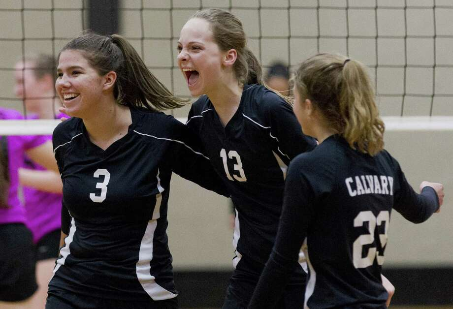Holland Guisler of Calvary Baptist (3) reacts beisde Hannah Riggens(13) after scoring a point during the third set of a TAPP District 10-1A olleyball match at First Baptist Church of Conroe on Thursday. Photo: Jason Fochtman, Houston Chronicle / Staff Photographer / © 2018 Houston Chronicle