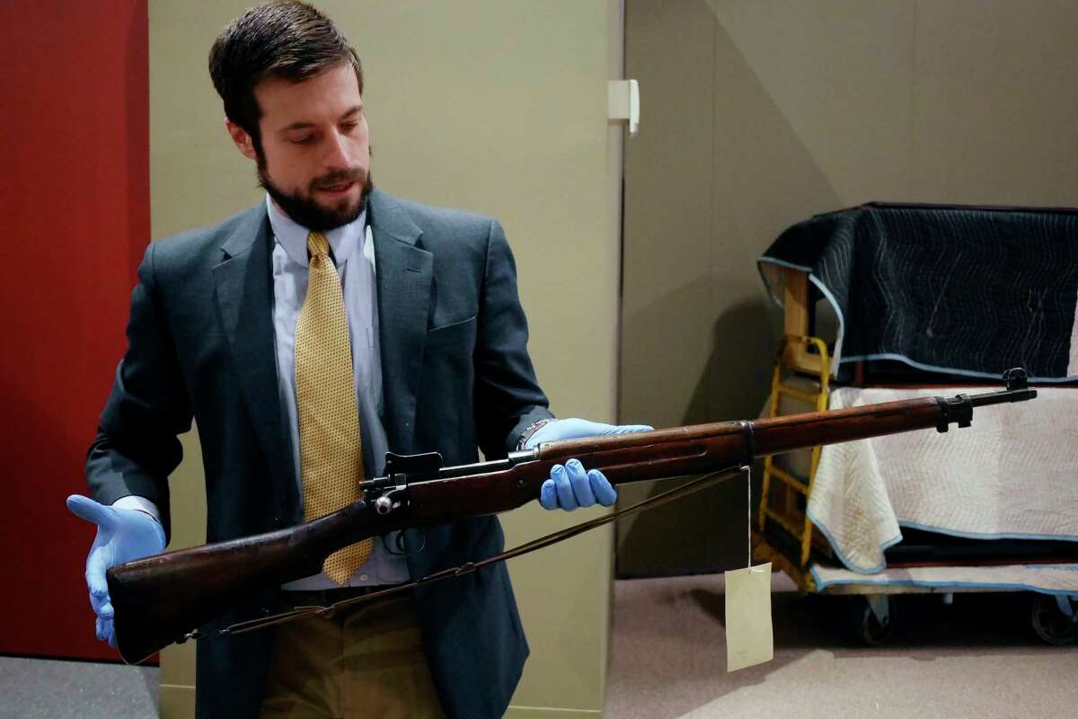 Aaron Noble, a senior historian at the New York State Museum, holds a 1917 American Enfield rifle made at Remington Arms in Ilion, N.Y., seen here on Thursday, Feb. 16, 2017 in Albany, N.Y. This item will be part of an exhibit on World War I at the State Museum. (Paul Buckowski / Times Union)