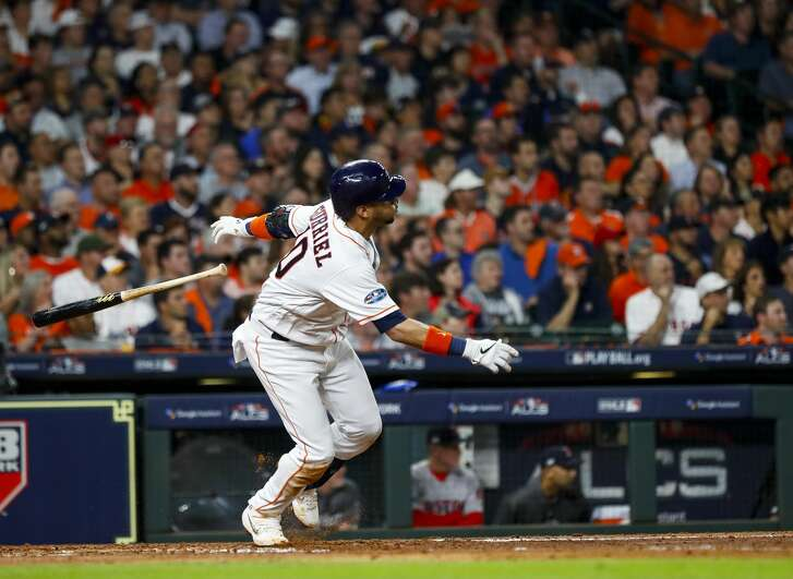 Houston Astros Yuli Gurriel (10) hits a double off of Boston Red Sox starting pitcher David Price (24) during the fourth inning of Game 5 of the American League Championship Series at Minute Maid Park on Thursday, Oct. 18, 2018, in Houston.