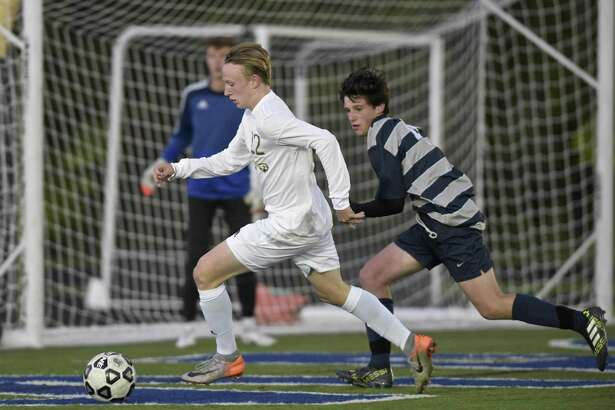 Barlow's Ben Goodace (22) cuts across the Immaculate goal with Immaculate's Ryan Fanelle (4) chasing in the boys soccer game between Joel Barlow and Immaculate high schools, Thursday evening, October 18, 2018, at Immaculate High School, Danbury, Conn.