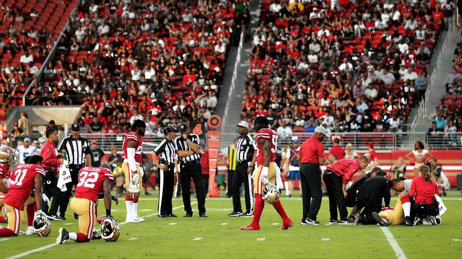 49ers' players take a knee as team personnel tend to Solomon Thomas (94) in the first quarter during the San Francisco 49ers game against the Dallas Cowboys at Levi's Stadium in Santa Clara, Calif., on Thursday, August 9, 2018. Photo: Carlos Avila Gonzalez / The Chronicle