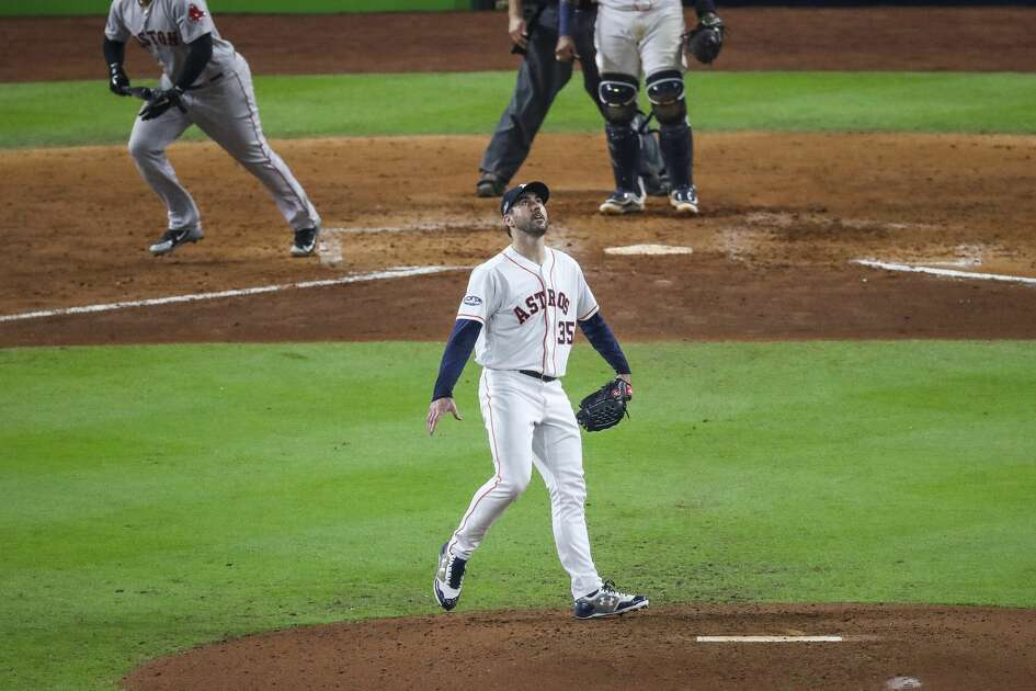 Houston Astros starting pitcher Justin Verlander (35) watches a home run hit by Boston Red Sox Rafael Devers (11) to give the Red Sox a 4-0 lead during the sixth inning of Game 5 of the American League Championship Series at Minute Maid Park on Thursday, Oct. 18, 2018, in Houston.