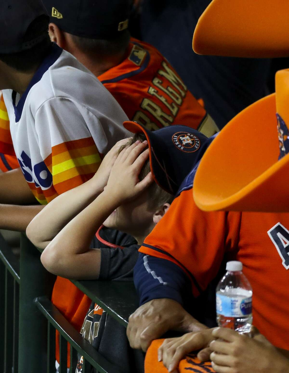 A young Astros fan reacts during the seventh inning of Game 5 of the American League Championship Series at Minute Maid Park on Thursday, Oct. 18, 2018, in Houston.