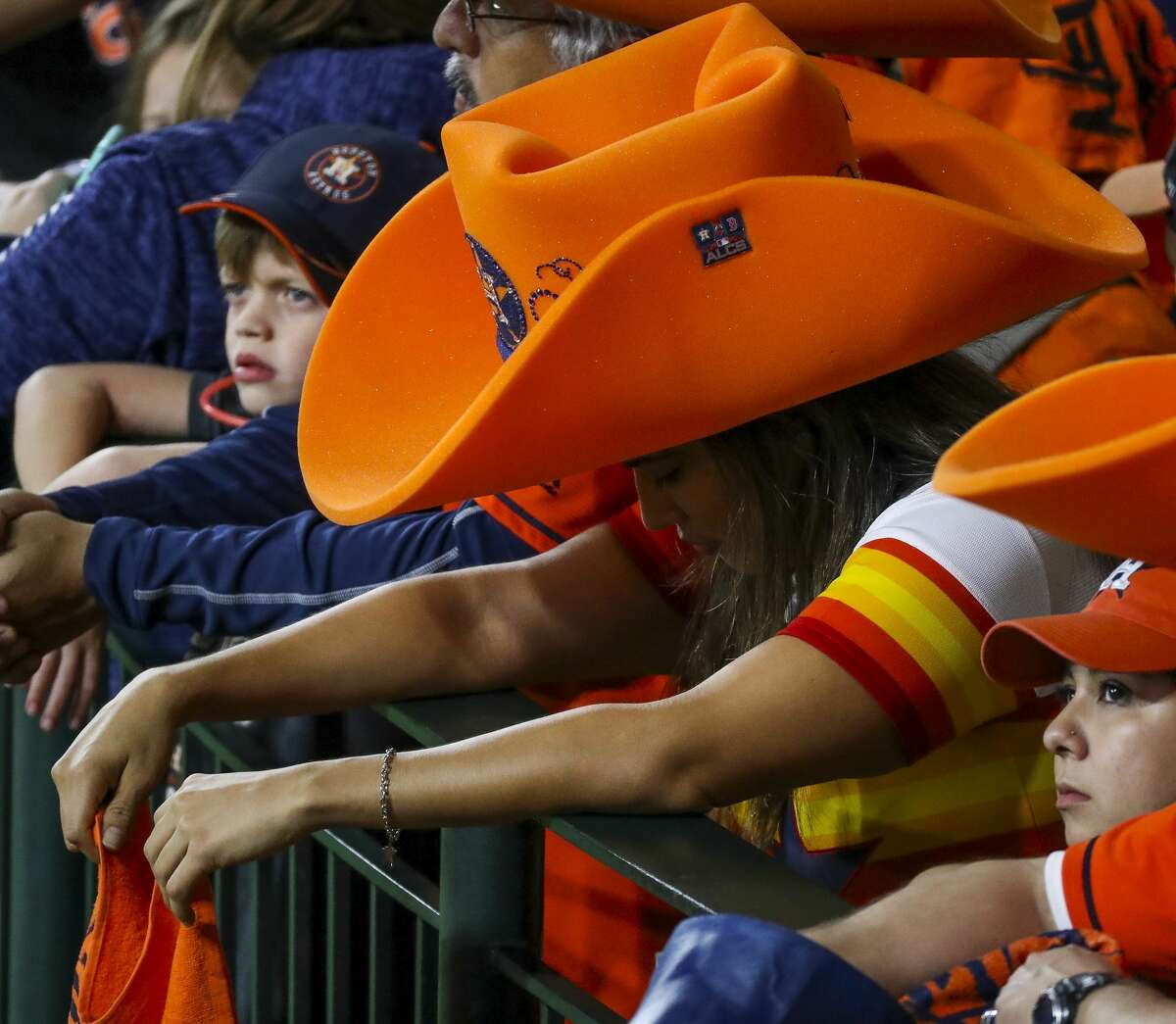 An Astros fan hangs her head during the seventh inning of Game 5 of the American League Championship Series at Minute Maid Park on Thursday, Oct. 18, 2018, in Houston.