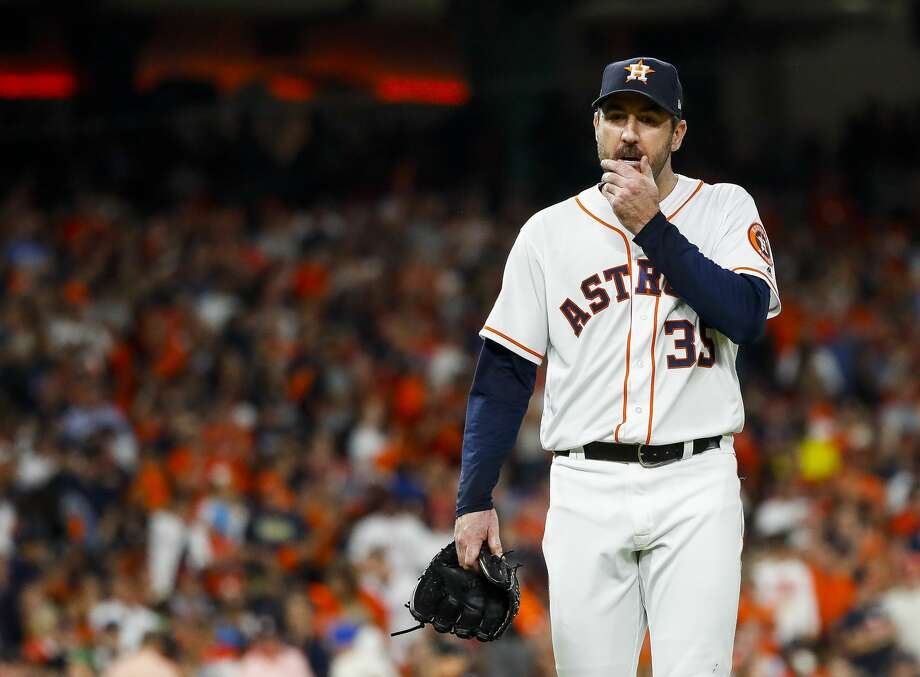 Houston Astros starting pitcher Justin Verlander (35) walks to the dugout at the end of the top of the fifth inning after allowing the Red Sox to take a 4-0 lead on a three-run home run by Boston Red Sox Rafael Devers (11) during Game 5 of the American League Championship Series at Minute Maid Park on Thursday, Oct. 18, 2018, in Houston. Photo: Karen Warren/Staff Photographer