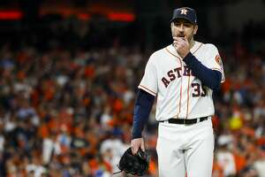 Houston Astros starting pitcher Justin Verlander (35) walks to the dugout at the end of the top of the fifth inning after allowing the Red Sox to take a 4-0 lead on a three-run home run by Boston Red Sox Rafael Devers (11) during Game 5 of the American League Championship Series at Minute Maid Park on Thursday, Oct. 18, 2018, in Houston.