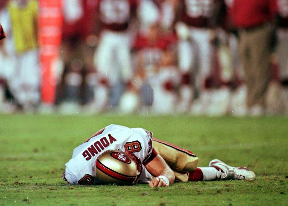 49ers quarterback Steve Young suffered a concussion against the Arizona Cardinals on Sept. 27, 1999, that ended his career. Photo: Scott Troyanos / Associated Press 1999