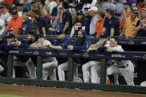 Members of the Houston Astros watch during the ninth inning in Game 5 of a baseball American League Championship Series against the Boston Red Sox on Thursday, Oct. 18, 2018, in Houston.