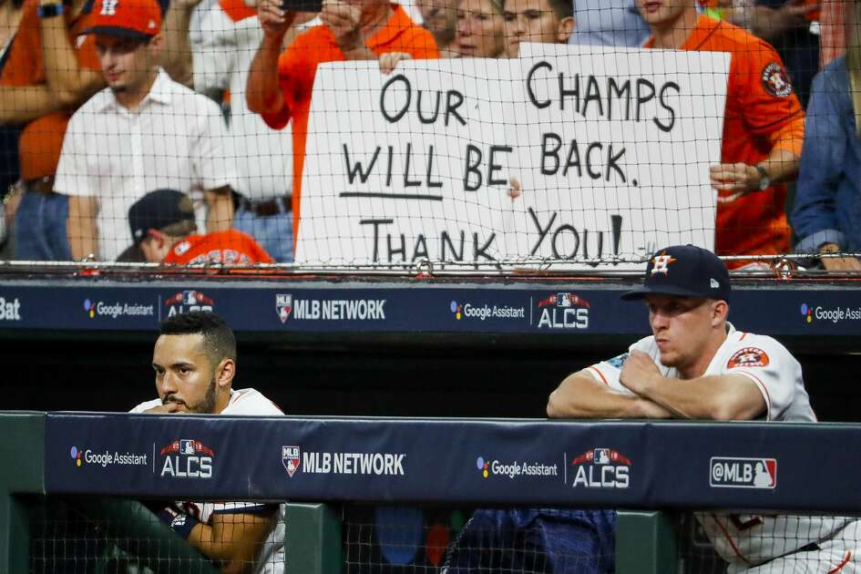 Houston Astros Carlos Correa (1) watches from the dugout at the end of Game 5 of the American League Championship Series at Minute Maid Park on Thursday, Oct. 18, 2018, in Houston.
