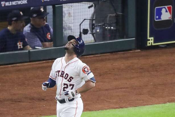 Houston Astros designated hitter Jose Altuve (27) reacts after lining out to Boston Red Sox Jackie Bradley Jr. (19) to strand one runner and end the eighth inning of Game 5 of the American League Championship Series at Minute Maid Park on Thursday, Oct. 18, 2018, in Houston.