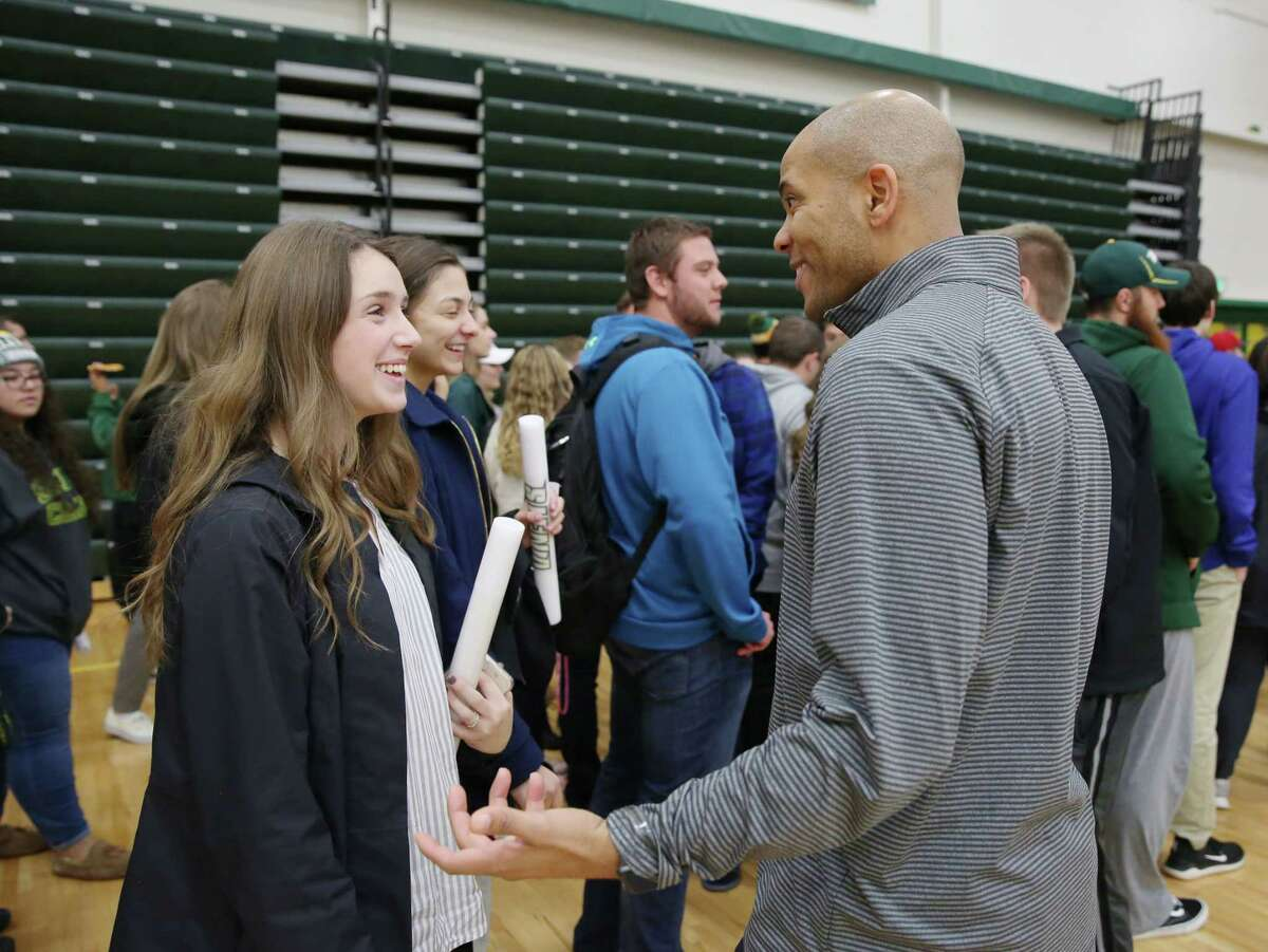 Siena mens basketball head coach Jamion Christian chats with freshmen Lauren Rock and Melina Vasil during Siena Madness Thursday, Oct. 18, 2018 at Siena?'s Alumni Recreation Center.