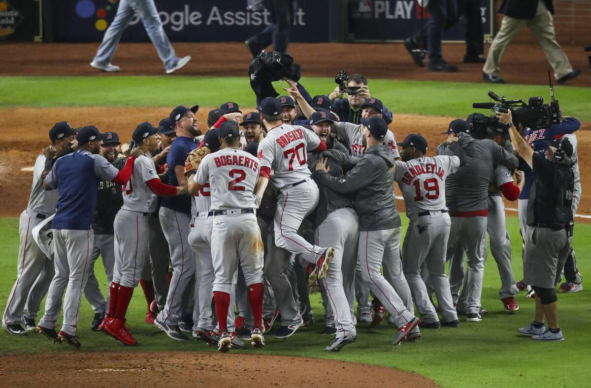 The Boston Red Sox celebrate after winning Game 5 of the American League Championship Series at Minute Maid Park on Thursday, Oct. 18, 2018, in Houston.