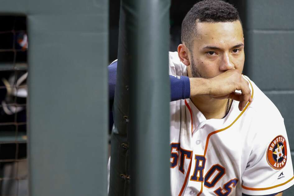 Houston Astros Carlos Correa (1) reacts from the dugout at the end of Game 5 of the American League Championship Series at Minute Maid Park on Thursday, Oct. 18, 2018, in Houston.