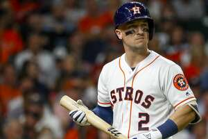 Houston Astros Alex Bregman (2) reacts after he strikes out swinging during the eighth inning of Game 5 of the American League Championship Series at Minute Maid Park on Thursday, Oct. 18, 2018, in Houston.
