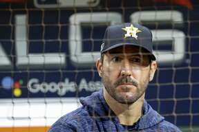 Houston Astros starting pitcher Justin Verlander (35) reacts from the dugout at the end of Game 5 of the American League Championship Series at Minute Maid Park on Thursday, Oct. 18, 2018, in Houston.