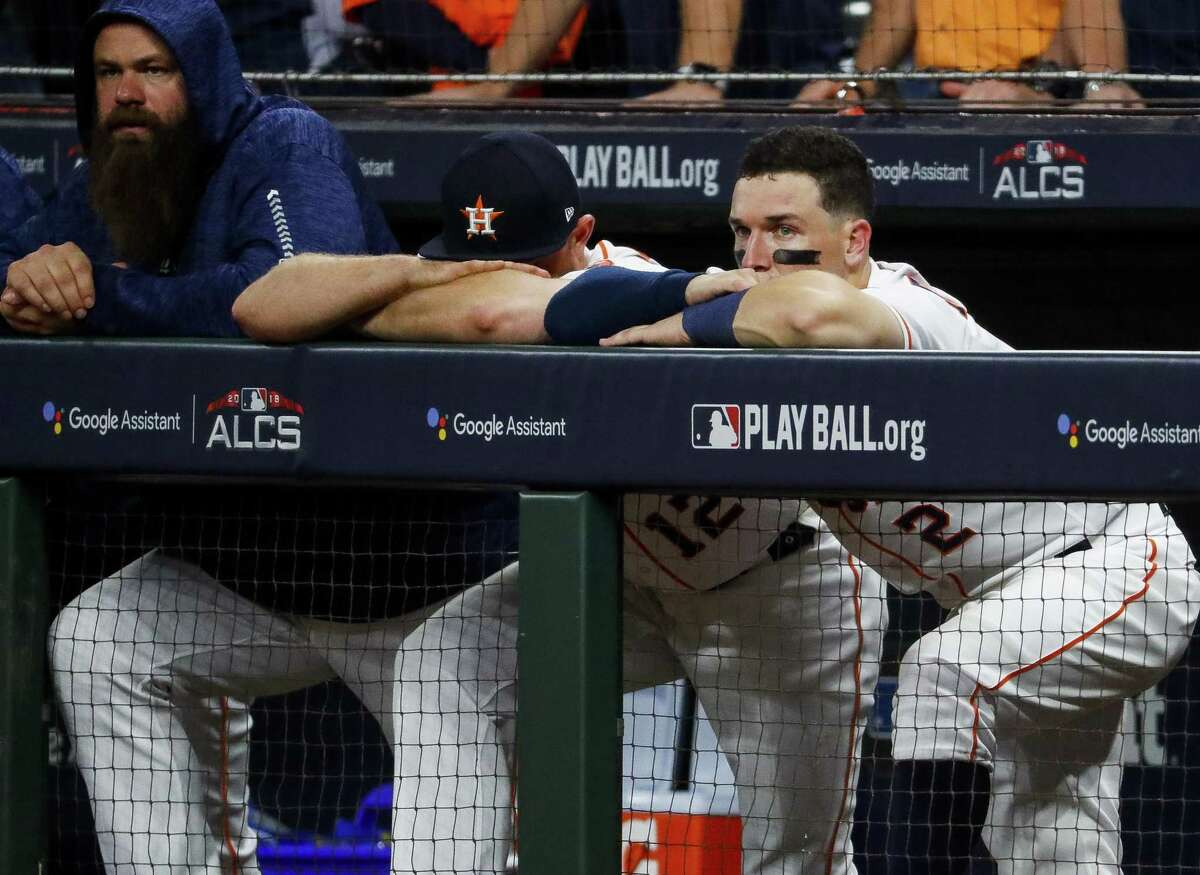 PHOTOS: More from the Astros' Game 5 loss to the Red Sox Third baseman Alex Bregman, right, watches glumly from the dugout as the Astros fail to mount a rally in the ninth inning.