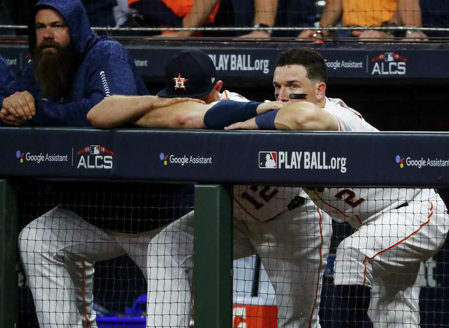 PHOTOS: More from the Astros' Game 5 loss to the Red Sox Third baseman Alex Bregman, right, watches glumly from the dugout as the Astros fail to mount a rally in the ninth inning. Photo: Brett Coomer, Houston Chronicle / Staff Photographer / © 2018 Houston Chronicle