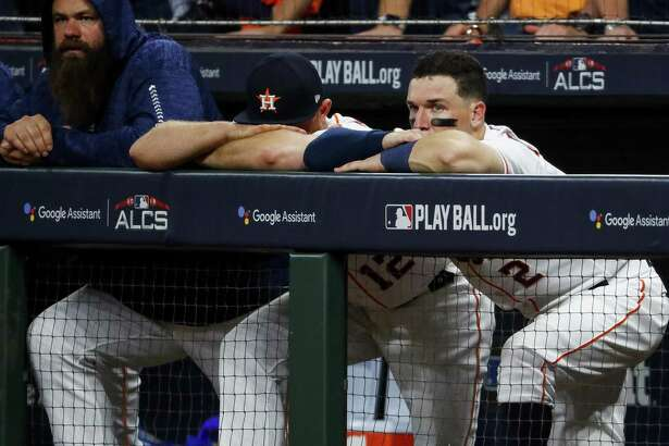 Tbird baseman Alex Bregman, right, watches glumly from the dugout as the Astros fail to mount a rally in the ninth inning.