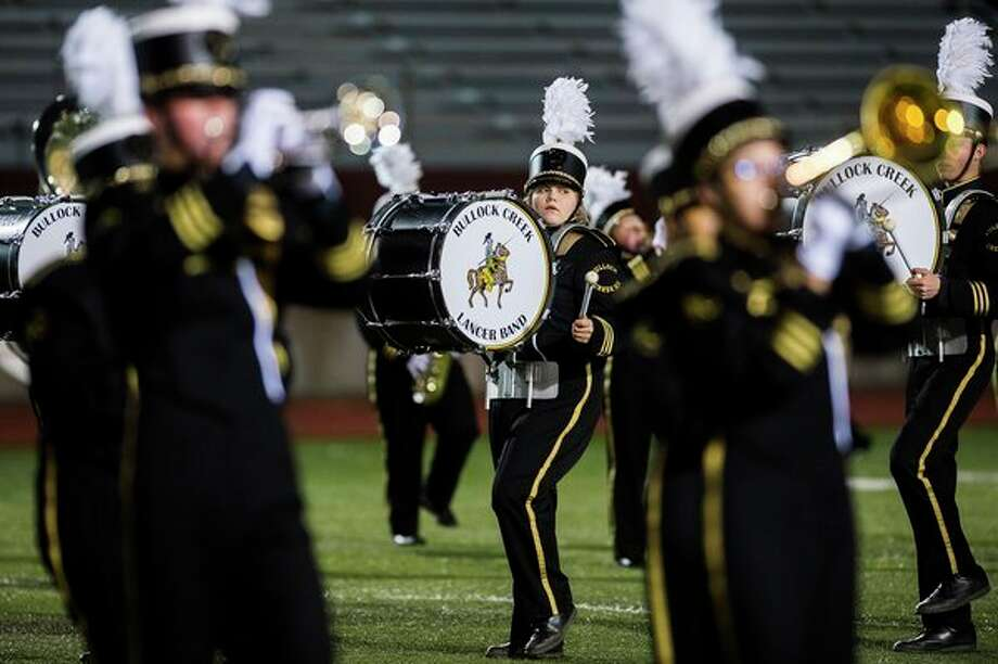 Members of the Bullock Creek High School marching band perform during the annual Midland Marching Band Showcase on Wednesday at Midland Community Stadium. (Katy Kildee/kkildee@mdn.net)