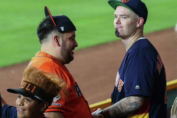 Houston rapper Paul Wall watches Game 5 of the American League Championship Series against Boston Red Sox from outfield at Minute Maid Park on Thursday, Oct. 18, 2018, in Houston.