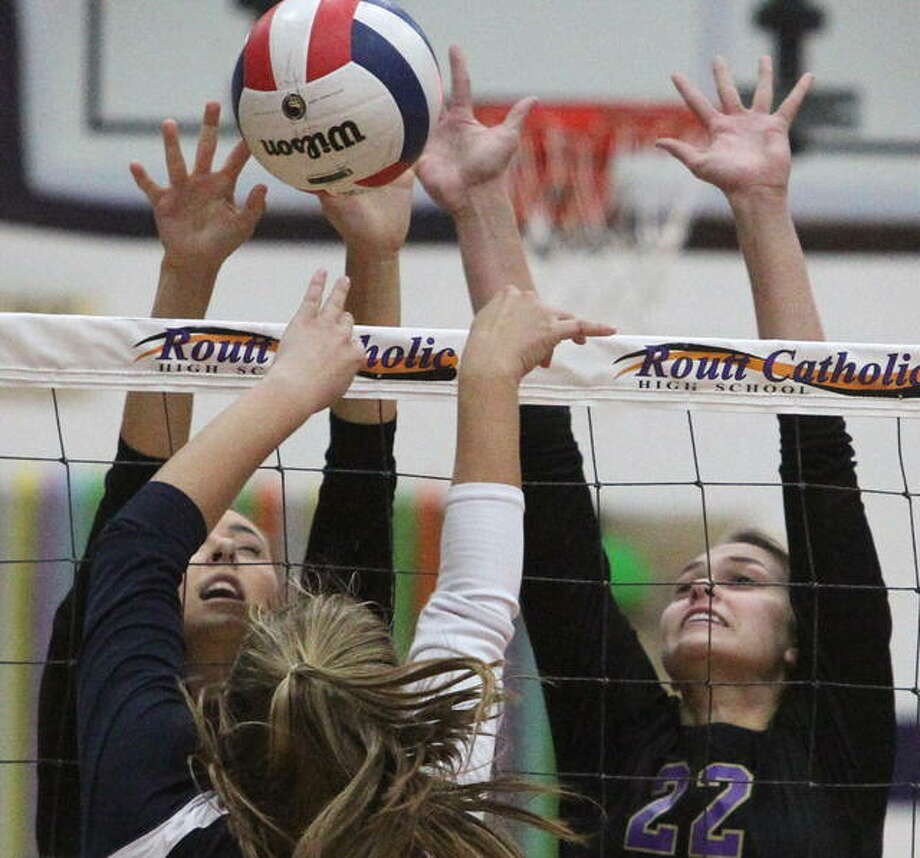 Routt's Addie Huey (right) and Ally Clay go up for a block during a high school volleyball match against New Berlin Thursday night at the Routt Dome in Jacksonville. Photo: Dennis Mathes | Journal-Courier