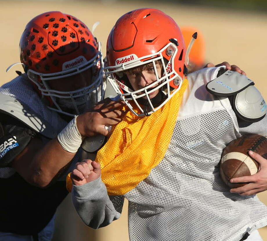 Greenfield-Northwestern players work on defense for Beardstown during practice earlier this week. Photo: Dennis Mathes | Journal-Courier