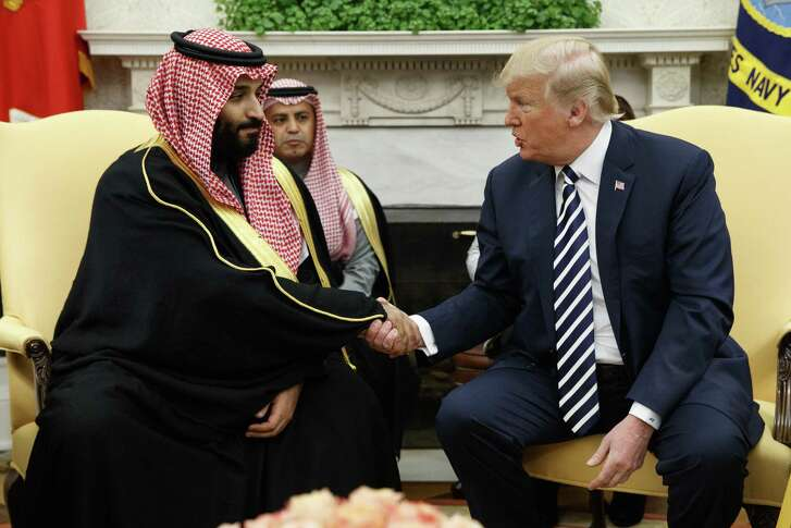 President Donald Trump shakes hands with Saudi Crown Prince Mohammed bin Salman in the Oval Office of the White House, Tuesday, March 20, 2018, in Washington.